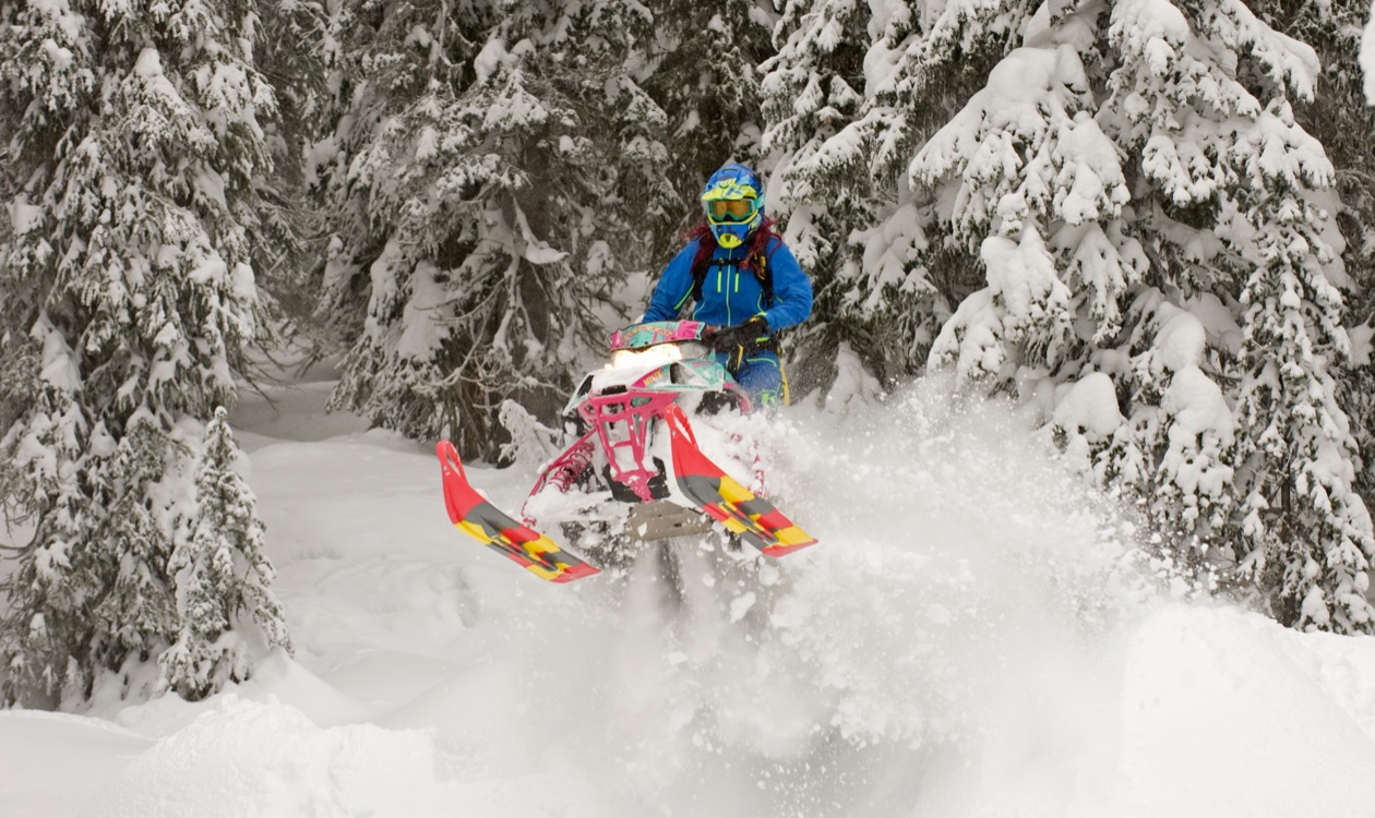 Slydog Skis on mountain snowmobile jumping through snow